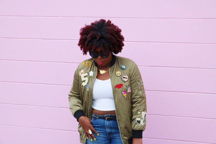 Natural Hair Blogger Orlando wearing sunnies, bomber, denim and pink adidas