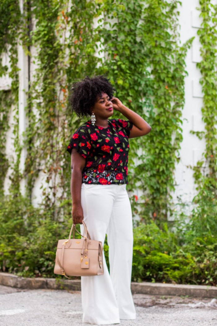 Blogger wearing Floral who what wear top and white pants